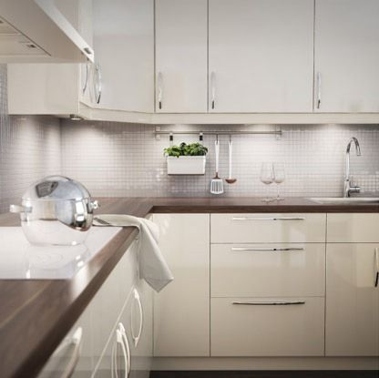 Ikea Kitchen   I like this, but would have used a different countertop and different handles on the cabinets