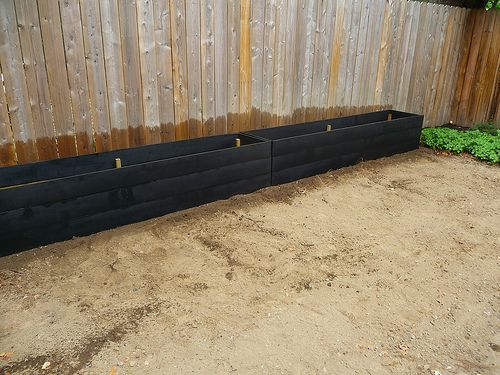 16 feet of planter goodness! --maybe this makes sense in the side yard? I have to figure out how much sun we get there.