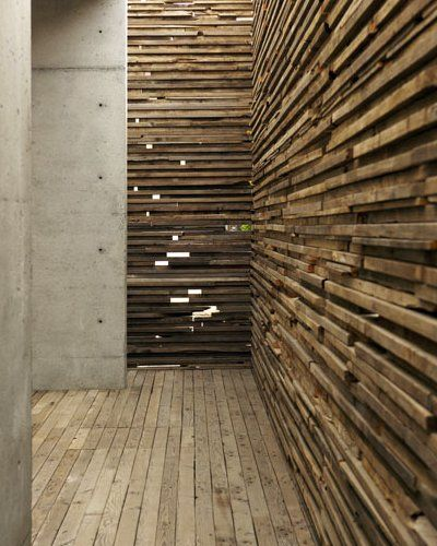 Sebastian Mariscal in Tijuana - stacked wood entrance wall