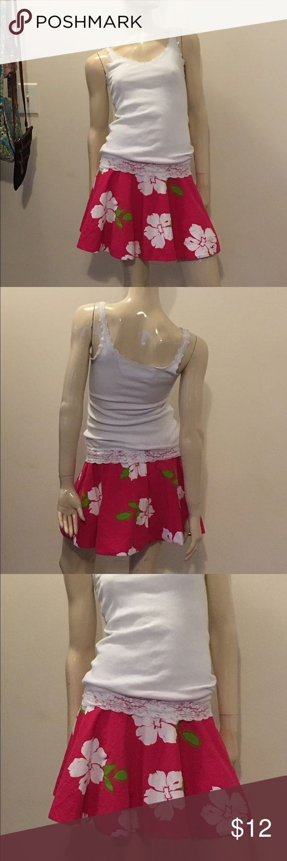 Cute size large Hollister skirt Cute pink floral print size large Hollister skirt, great condition and gently used. Hollister Skirts Mini