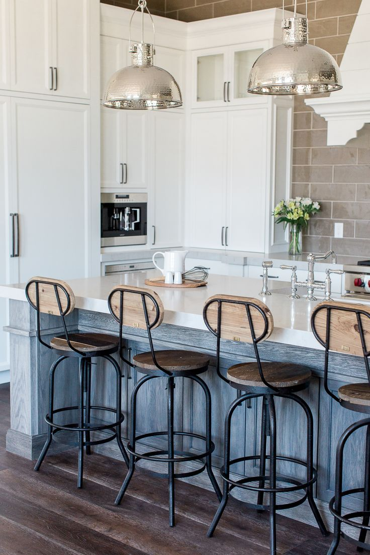 Custom kitchen with white perimeter cabinetry and natural grey island - by Rafterhouse.