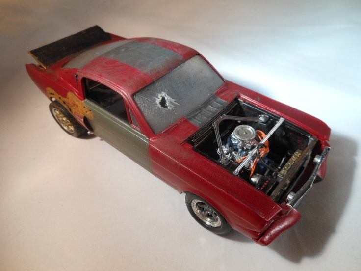 1960s Ford 1/24 scale mustang model car in red.