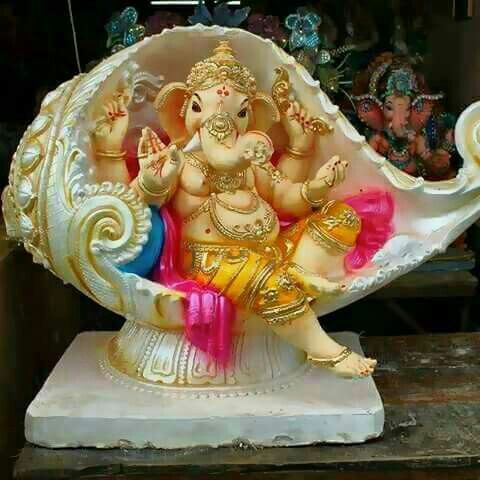 Really beautiful idea to place Ganesh inside a shell.  He looks so happy!
