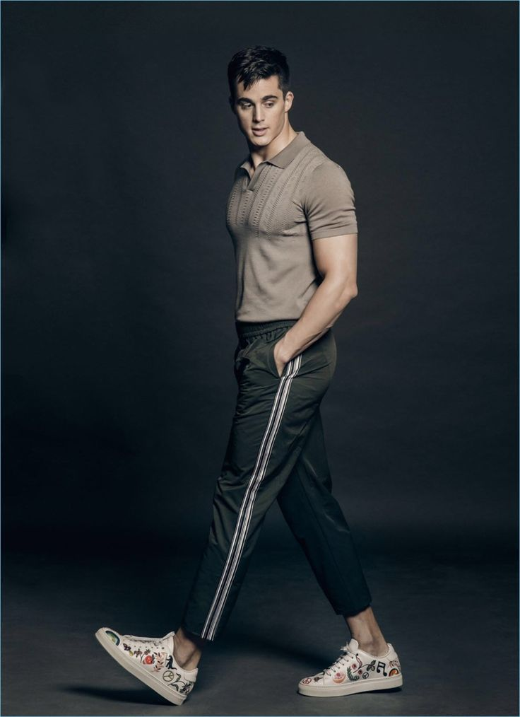 Strutting his stuff, Pietro Boselli dons a BENCH polo with Wood Wood pants and Paul Smith sneakers.