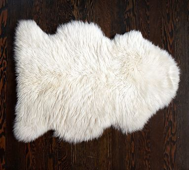 Sheepskin Rug looks great in any room and even looks great on the back of a couch or covering up a chair.