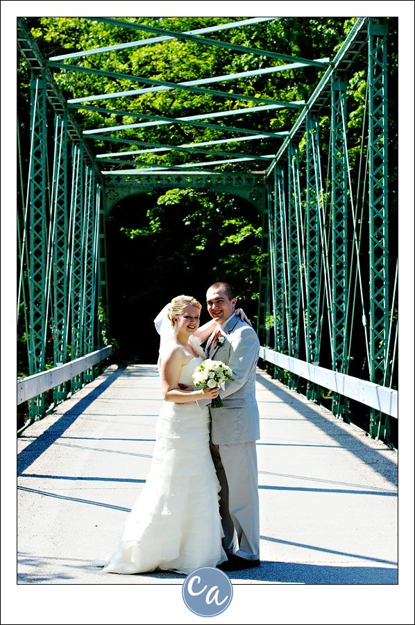 wedding picture locations akron ohio%0A bride and groom posing on an iron bridge in ohio Near Manakiki