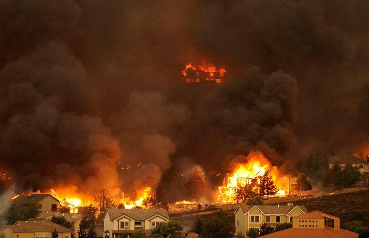 The Waldo Canyon fire burns an entire neighborhood near the foothills of Colorado Springs, Colorado