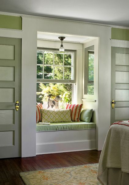 """He also created a window seat, or what he calls """"a charming moment"""" between two closets. Mirrored panels at the sides of the window seat create the illusion that the seat is in a bay window.... traditional bedroom by Francis Dzikowski Photography Inc."""