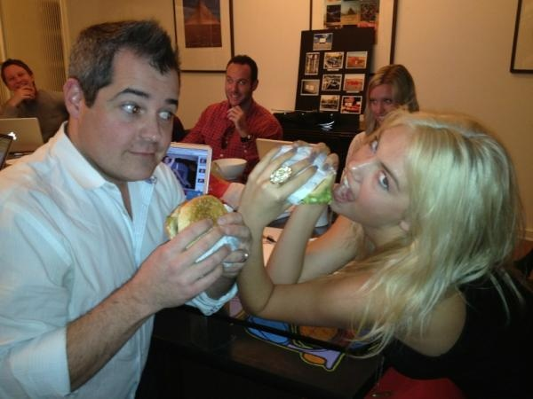 On the set: Kate Upton practices her biting techniques on a Hardee's/Carl's Jr. Southwest Patty Melt.