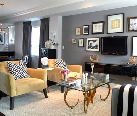 Yellow and gray living room with frames surrounding the tv