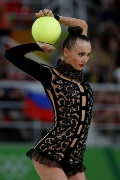Ukraine's Ganna Rizatdinova competes in the individual all-around final event of the Rhythmic Gymnastics at the Olympic Arena during the Rio 2016 Olympic Games in Rio de Janeiro on August 20, 2016. / AFP / Thomas COEX