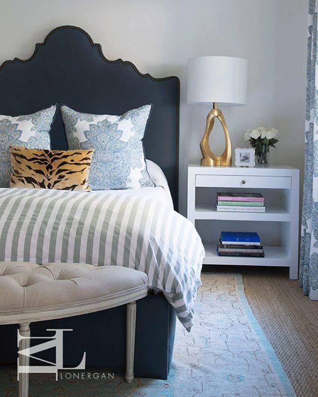 Elegant bedroom with dark blue arched bed