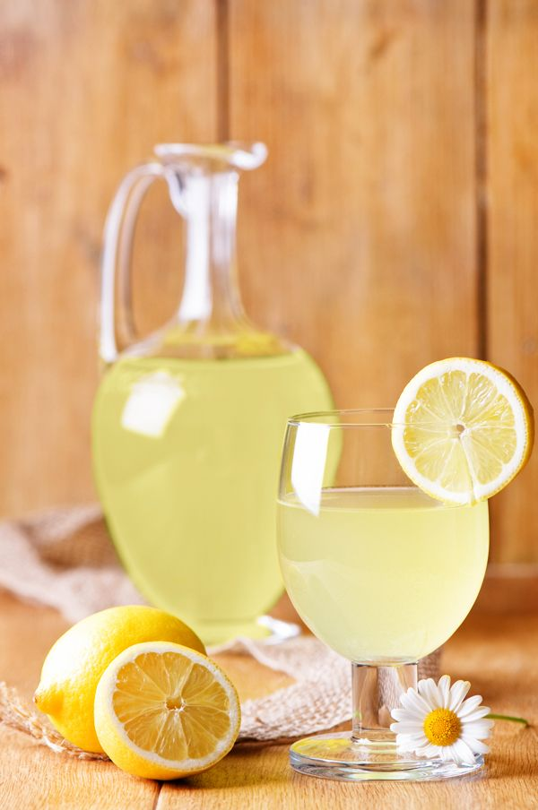Sunny's Hard Lemonade | 2 cups water 1 c sugar 8 c ice 4 oz vanilla-infused vodka 1 c lemon juice 1 lemon, sliced 1 lime, sliced | Bring water and sugar to a simmer, dissolve sugar. Remove from heat, let cool | Fill large pitcher with ice. Stir in simple syrup, vodka, juice, lemon and lime slices || Vanilla-infused Vodka | 1 l. vodka 2 vanilla beans | Split beans, add to vodka bottle. Let infuse overnight in a cool dark place. Strain into sterilized bottle | foodnetwork.com