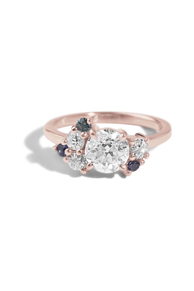 This Personalized Diamond Cluster Ring is set with Iolite, sapphire, and diamonds.