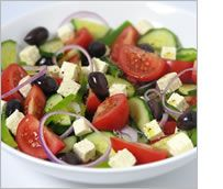 GREEK SALAD  --   juicy tomatoes, crisp cucumber, sliced red onion, green pepper, crumbly feta cheese and plump kalamata olives with a dressing of olive oil, lemon juice, garlic, salt, pepper and oregano