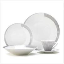 Contemporary dinnerware set features a playful black and white striped rim and sleek, modern shaping. An understated ensemble that makes any meal into a celebration of style! Includes serving set for 4: dinner plate, soup plate, salad plate, cup a...