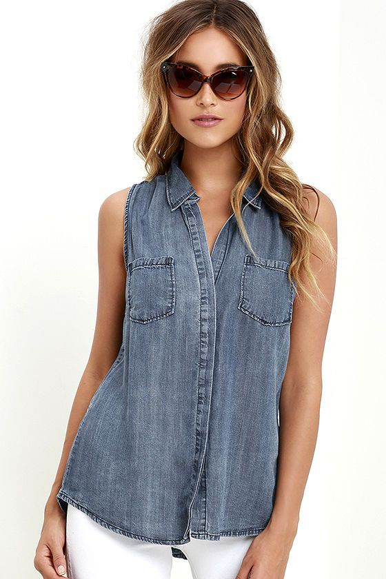 Meetings, lunch dates, and after hours cocktails could all use the Courtesy Collar Blue Chambray Top! Deep blue chambray is perfectly lightweight across a collared neckline, and sleeveless, darted bodice with hidden button placket (and slit at back). Two front patch pockets.