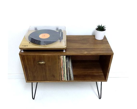 OUR CLASSIC VINYL STORAGE TABLE  This is a made to order quality solid wood hand crafted vinyl console table / side table. The design of this table was inspired by mid century Danish minimalist furniture. It would look great in any room as a record table, console table, or side table. The shelf compartment is designed to fit your vinyl records perfectly.  This table is designed and hand crafted in our workshop using quality solid pine for the body which is hand stained in a wood color of...