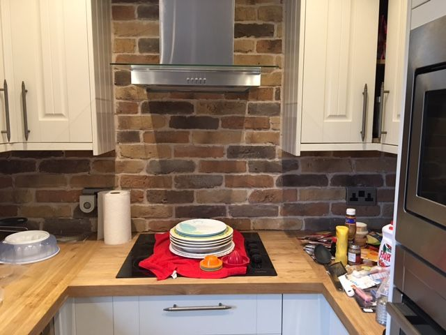 Residential kitchen project using Autumn Blend Rustic Brick Slips and an off white mortar