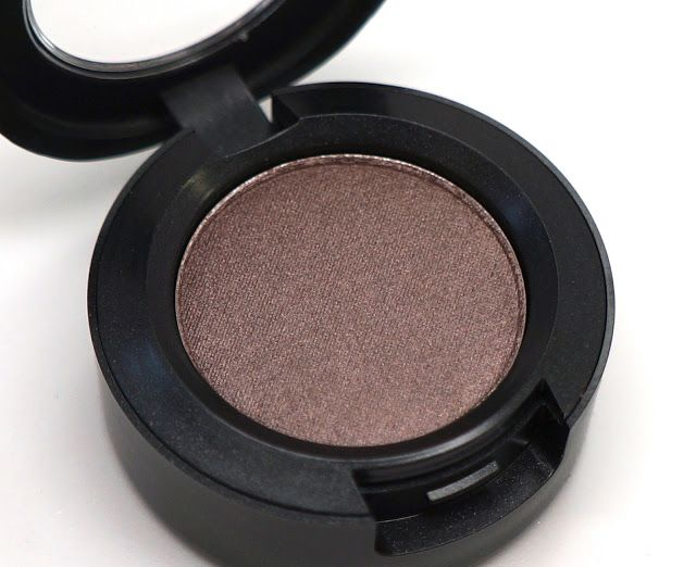 Mac Satin Taupe - a gorgeous purple brown with silver shimmer.  Though technically a cool shade, there are enough warm and cool tones in the shadow to make it universally flattering on all undertones.