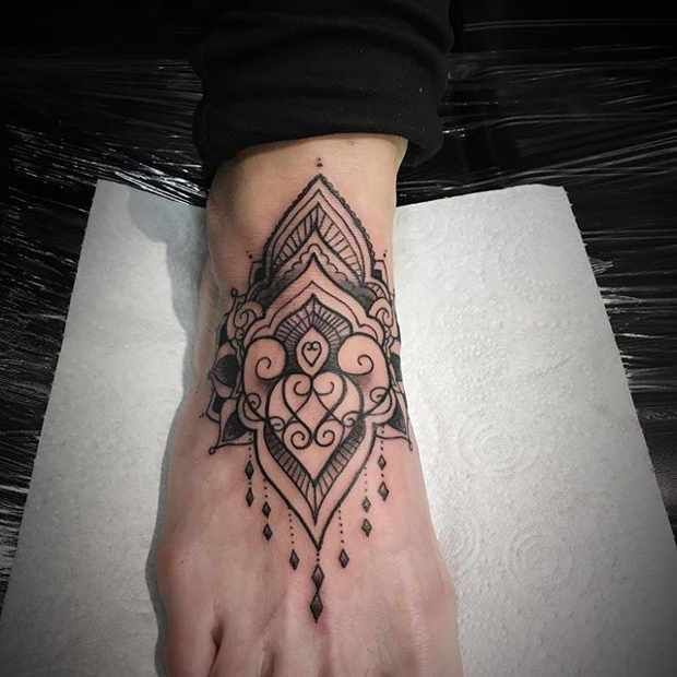 21 Trendy Mandala Tattoo Ideas for Women: #2. MANDALA FOOT TATTOO