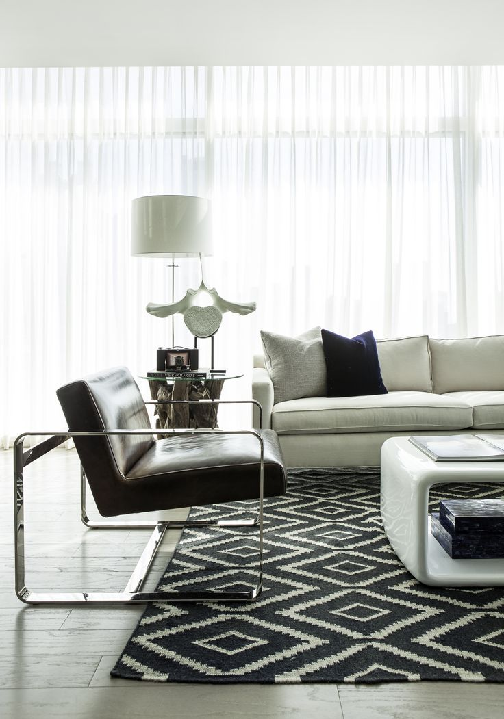 Stunning Penthouse Design With Exclusive Decoration: Cozy Downtown  Penthouse Living Rppm Modern Leather Chair Patterned Caarpet