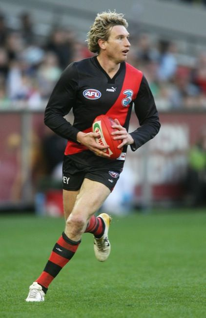 Own a guernsey signed and worn by James Hird.