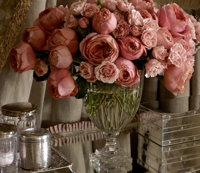 Old world flair - dusky pink roses, taupe curtains, and vintage silver vanities..