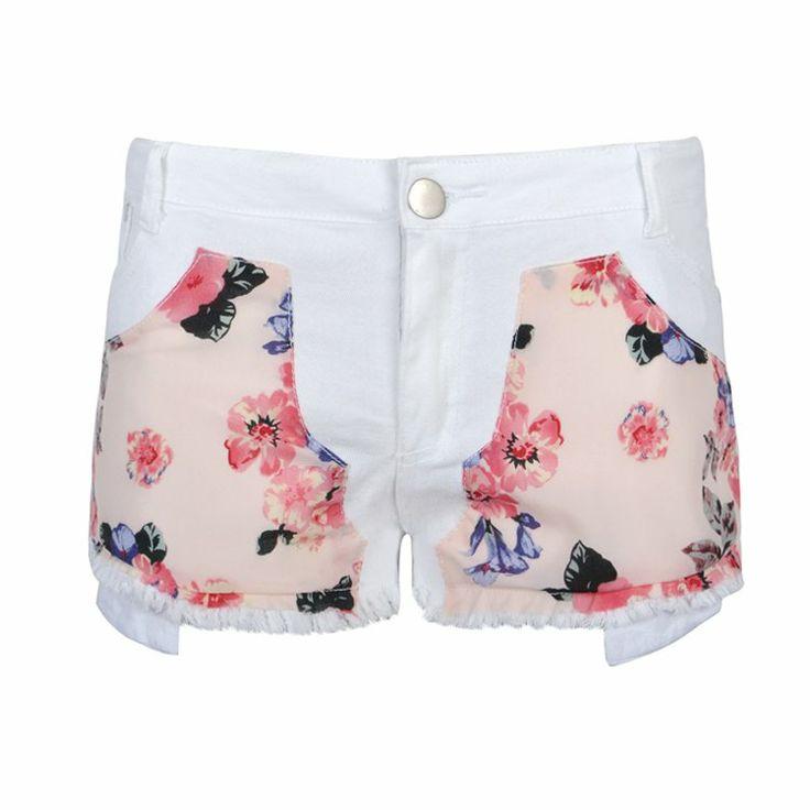 Denim short with floral patchwork and frayed hem.
