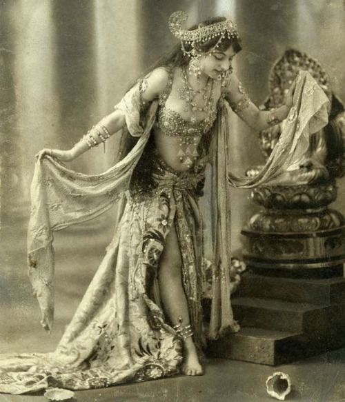 Mata Hari performs a Javanese Dance in 1905.    Or at least her version of a Javanese dance! She had lived in that region of the world for a few years during her marriage, and her costume is (very loosely) based on that of Wayang dancers, but I think we can safely say it's pretty much Mata Hari's creation.