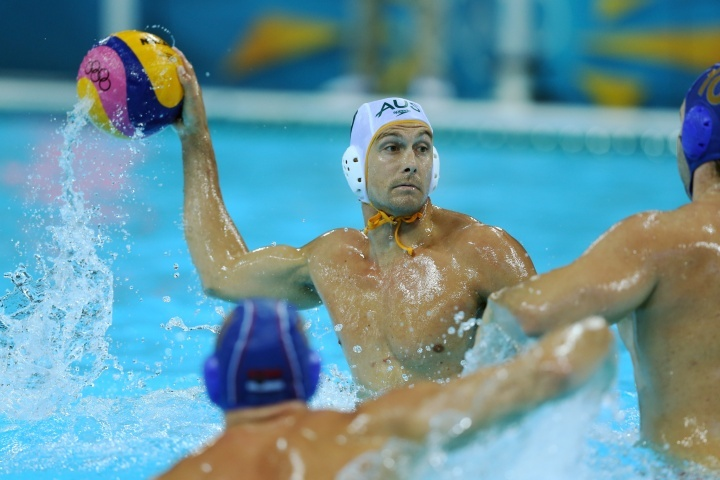 Whalan against Serbia          Thomas Whalan #9 of Australia passes the ball in the Men's Water polo quarterfinal match between Australia and Serbia on Day 12 of the London 2012 Olympic Games at Water Polo Arena on August 8, 2012 in London, England.          © Clive Rose/Getty Images