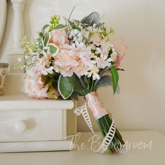 Ashlyn is such a pretty bouquet blooms in light pink white and a dash of sage green to compliment. #bloomroomdesigns #wedding #weddingday #weddinginspiration #destinationwedding #foreverbouquet #love #bridalinspo #silkweddingflowers #weddingbouquet #brida