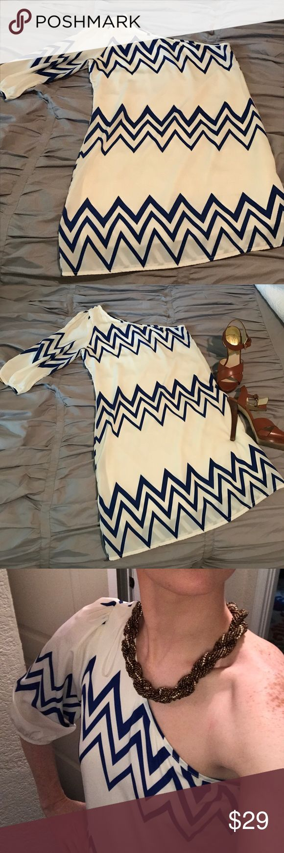 Boutique one shouldered cream & blue chevron dress Adorable blue and cream chevron one shoulder party dress! Boutique find, never worn other than fitting. Dress length is just above knee, quarter sleeve is just above elbow. Fits comfortably around the bust (34B bust) and is a flowy sheath silhouette. Perfect for dinner or a night on the town paired with wedges this summer! Peach Love Cream Dresses One Shoulder