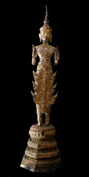 Rattanakosin Gilt Bronze Sculpture of the Walking Buddha Origin: Thailand Circa: 18 th Century AD to 19 th Century AD