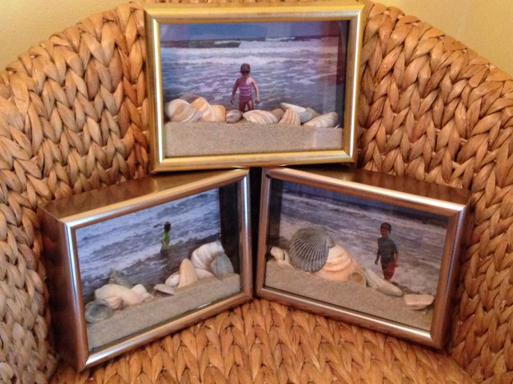 Shadow box souvenirs showcasing the grandkids first visit to the Atlantic Ocean. Filled with their picture of them standing in the ocean with Sand and shells they collected.