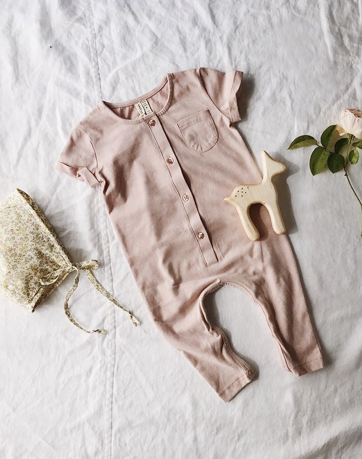 Perfect from day to night. This playsuit in blush is our go-to outfit for your organic baby. Sweet for a baby girl or gender neutral baby shower gift. Pairs well with a floral baby bonnet and a wooden teether.