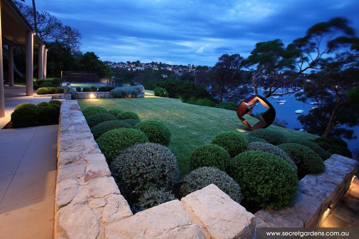 Low planting, open lawn and the placement of the sculpture have been used to draw your eye toward the view
