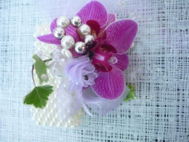 Pink orchid lady's corsage with hint of pearl beads