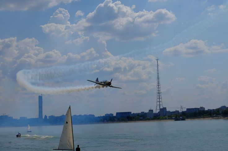 transportation, flying, airplane, air vehicle, travel, airshow, mode of transport, outdoors, fighter plane, water, smoke - physical structure, aerobatics, motion, no people, vapor trail, business finance and industry, helicopter, day, teamwork, sky, military airplane