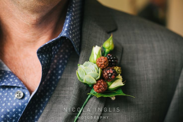 Buttonhole with Mini white roses, succulents and boysenberries, created by Florist ilene, Hamilton NZ