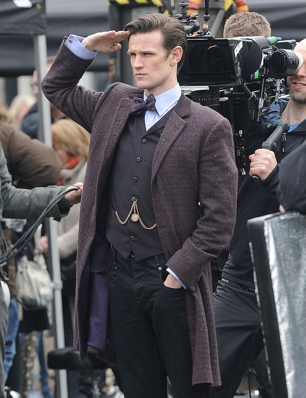 Matt Smith standing to attention filming Doctor Who in Trafalgar Square.