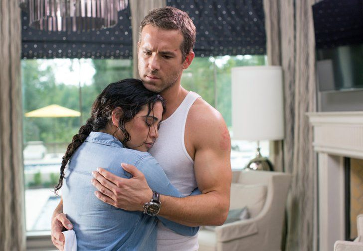 Pin for Later: Exclusive: 3 Reasons to See Self/less That Involve Ryan Reynolds These Biceps Look how happy costar Natalie Martinez is. Can you blame her?
