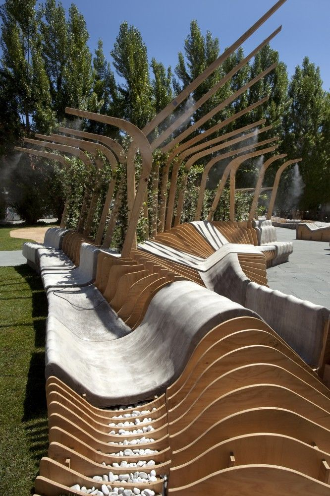 Yoga inspired outdoor seating with QR Codes for more info by UNIRE/UNITE at MAXXI (Young Architects Program) / Urban Movement Design