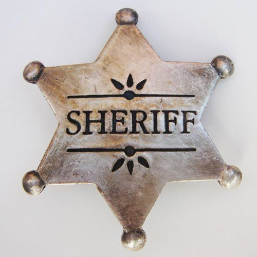 "Silver Sheriff Badge - Old West Cowboy Law 1900s Obsolete Police Badge by UD. $9.99. Complete any cowboy costume with this historically accurate old west Sheriff Law Badge. Sheriff Law Badge is historically accurate with six pointed star and pin back. Sheriff Police Badge measures 2.25"" inches long from point to point and has a vertically-aligned pin on the back, just like the real thing. Sheriff Badge is a replica of an old west style police badge and has no e..."