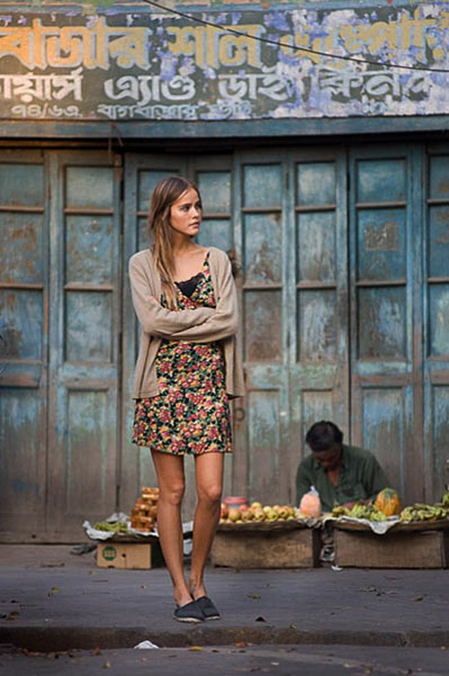 isabel lucas, model. Her faux-thrifted, carefully cultivated hipster attire cost more than that poor man behind her makes in a year.