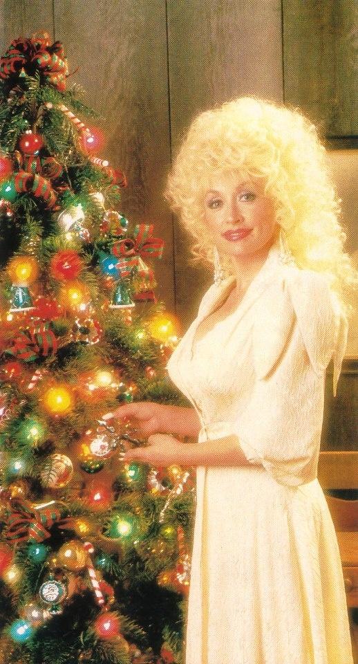 Dolly Parton decorating the Christmas tree.