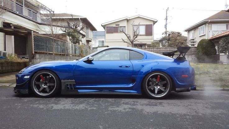 Toyota supra in blue, slammed, modified and wide body