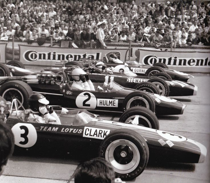 1967 German GP at the Nürburgring: Jim Clark, Denny Hulme, Jackie Stewart and Dan Gurney don their goggles before the flag drops.
