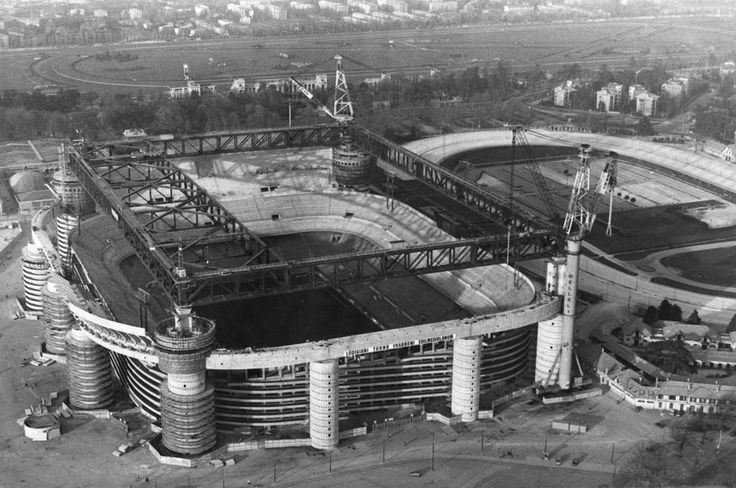 The Stadio Giuseppe Meazza or the San Siro Stadium in Milan was originally designed by architect Stacchini and engineer Cugini in 1925 based on an Anglo-Saxon model. The structure was made up of four back straight bleachers, one of which was partially covered, and could contain up to 35,000 spectators.