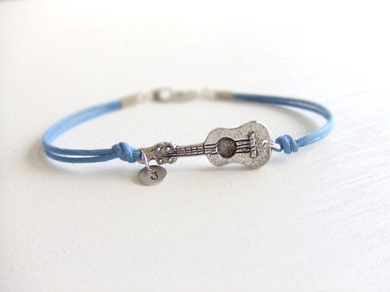 Ukulele bracelet -- just got mine in the mail. I love it! :-D